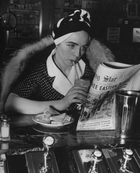 News woman readign newspaper